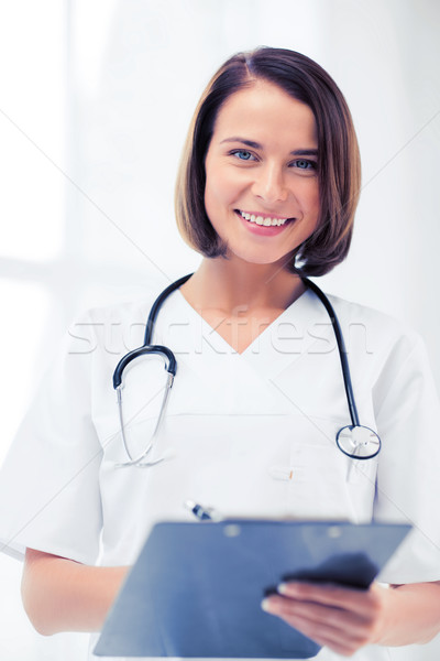 doctor with stethoscope writing prescription Stock photo © dolgachov