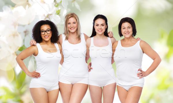 group of happy different women in white underwear Stock photo © dolgachov