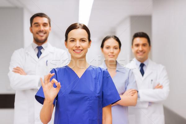 группа больницу вызывать рукой знак клинике Сток-фото © dolgachov