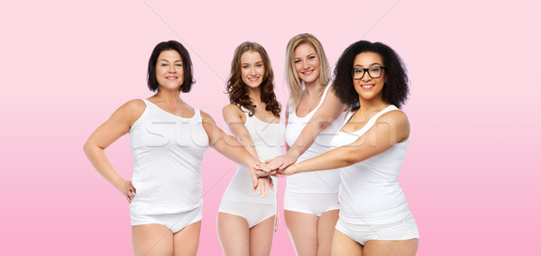 Stock photo: group of happy different women with hands on top