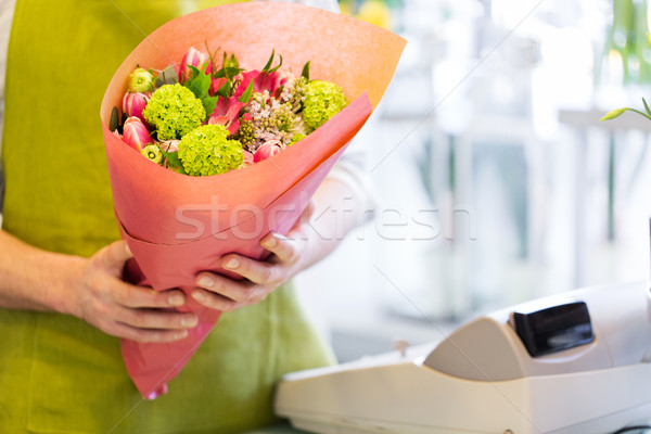 close up of florist with bunch at flower shop Stock photo © dolgachov