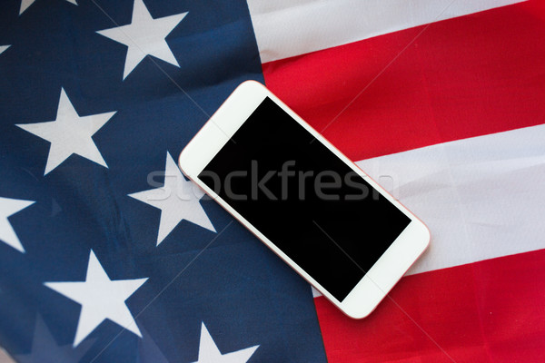 close up of smartphone on american flag Stock photo © dolgachov