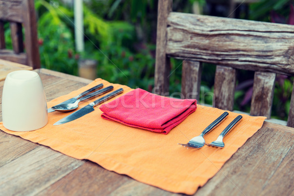 close up of cutlery with glass and napkin on table Stock photo © dolgachov