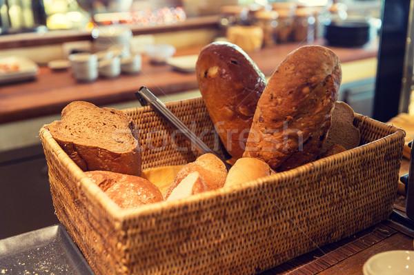 basket with bread at restaurant Stock photo © dolgachov