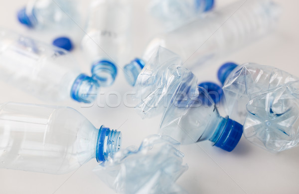 close up of empty used plastic bottles on table Stock photo © dolgachov
