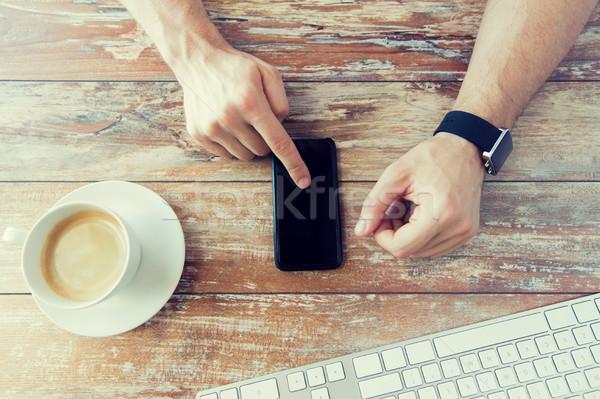 Közelkép kezek okostelefon óra üzlet technológia Stock fotó © dolgachov