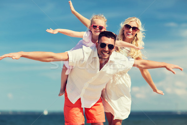 happy family having fun on summer beach Stock photo © dolgachov