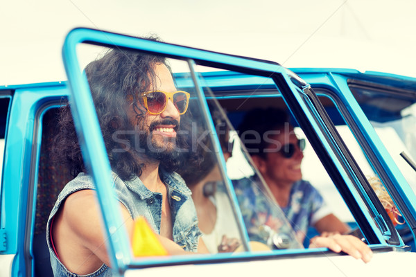 smiling young hippie friends in minivan car Stock photo © dolgachov