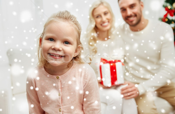 Stock photo: happy family at home with christmas gift box