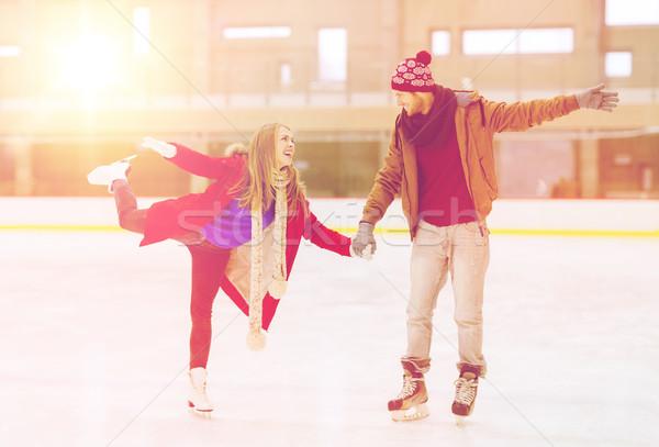 Mutlu çift el ele tutuşarak pateni insanlar Stok fotoğraf © dolgachov