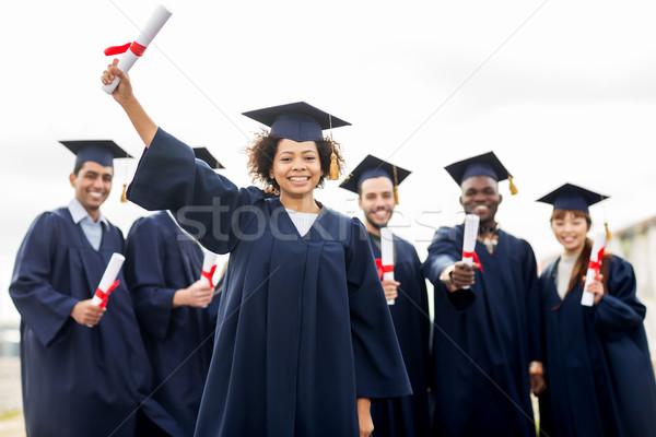 Stockfoto: Gelukkig · studenten · onderwijs · afstuderen · mensen · groep