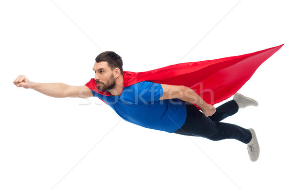 man in red superhero cape flying on air Stock photo © dolgachov