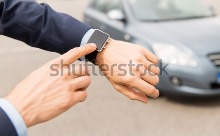 close up of man checking blood sugar by glucometer Stock photo © dolgachov