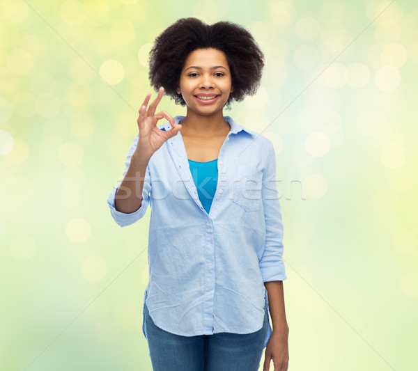 happy african american woman showing ok hand sign Stock photo © dolgachov