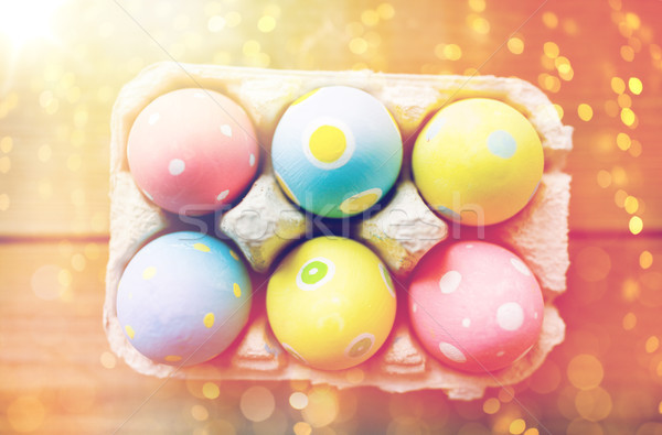 close up of colored easter eggs in egg box Stock photo © dolgachov