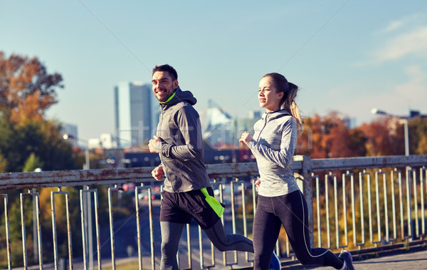 happy couple running outdoors Stock photo © dolgachov