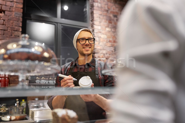 Stock photo: man or barman with coffee cup and customer at cafe