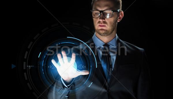 Zakenman aanraken virtueel scherm projectie zakenlieden Stockfoto © dolgachov
