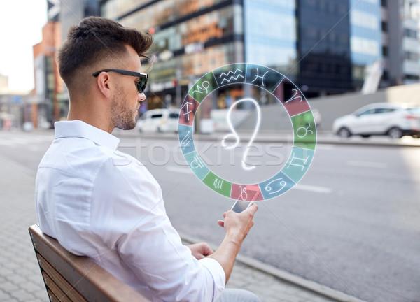 Férfi okostelefon állatöv feliratok város technológia Stock fotó © dolgachov