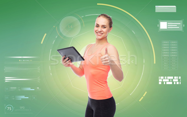 happy smiling sportive young woman with tablet pc Stock photo © dolgachov