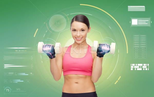 Feliz mulher halteres bíceps esportes Foto stock © dolgachov