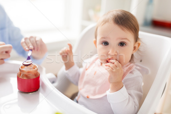 mother feeding baby with puree at home Stock photo © dolgachov