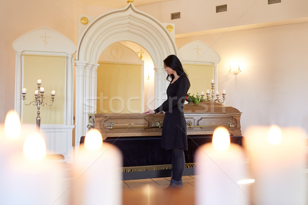 sad woman with coffin at funeral in church Stock photo © dolgachov