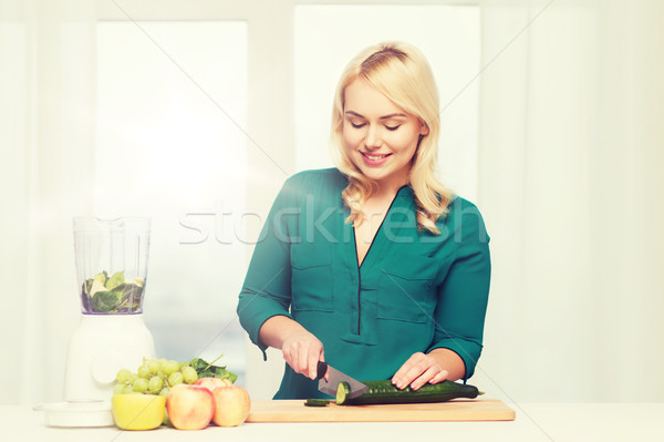smiling woman with blender cooking food at home Stock photo © dolgachov