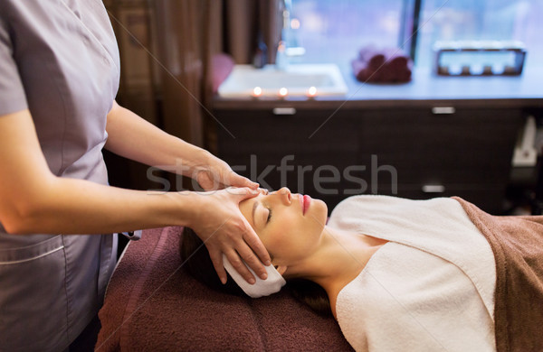 woman having face and head massage at spa parlor Stock photo © dolgachov