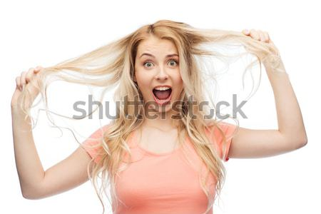 happy young woman shouting or calling someone Stock photo © dolgachov