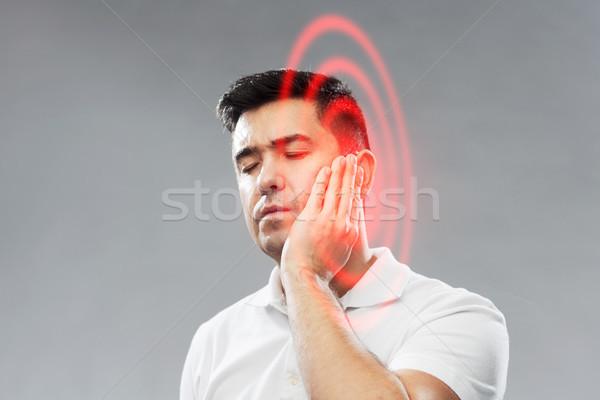 Boldogtalan férfi szenvedés fogfájás emberek egészségügy Stock fotó © dolgachov
