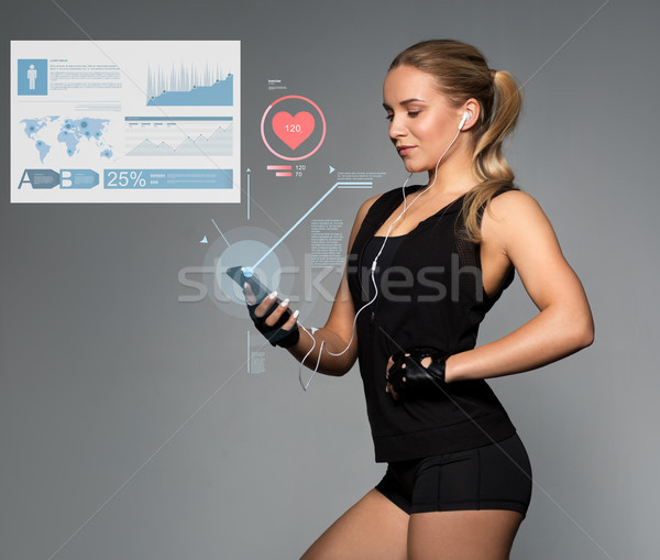 Kobieta smartphone wykresy puls sportu Zdjęcia stock © dolgachov