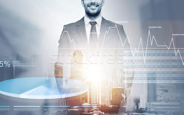 close up of happy businessman over city background Stock photo © dolgachov
