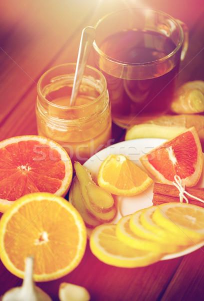 Jengibre té miel agrios ajo madera Foto stock © dolgachov