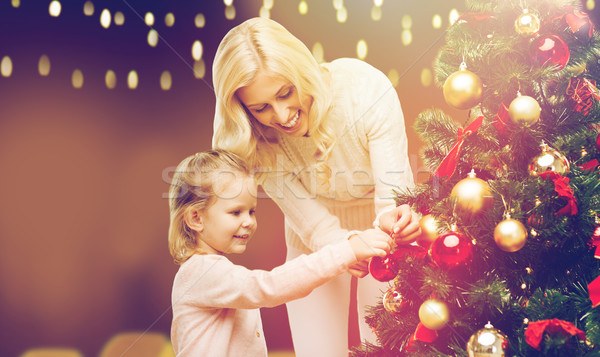 mother and daughter decorating christmas tree Stock photo © dolgachov