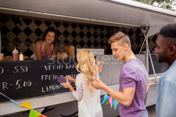 happy customers queue at food truck Stock photo © dolgachov