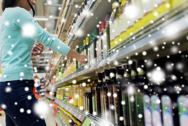 Client huile d'olive supermarché vente Shopping Photo stock © dolgachov
