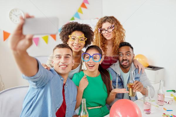 happy team taking selfie at office party Stock photo © dolgachov