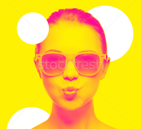 girl in pink sunglasses blowing kiss Stock photo © dolgachov