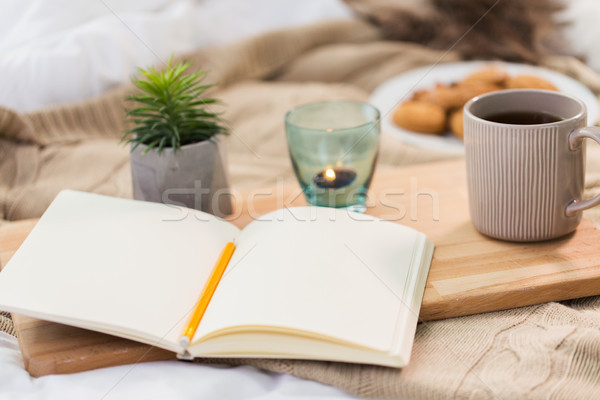 diary, tea and candle in holder at home Stock photo © dolgachov