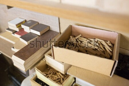 wood dowel pins and board samples at workshop Stock photo © dolgachov