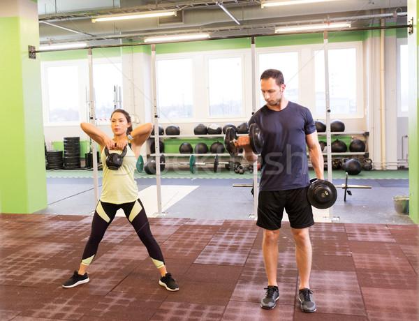 Férfi nő kettlebell testmozgás tornaterem sport Stock fotó © dolgachov