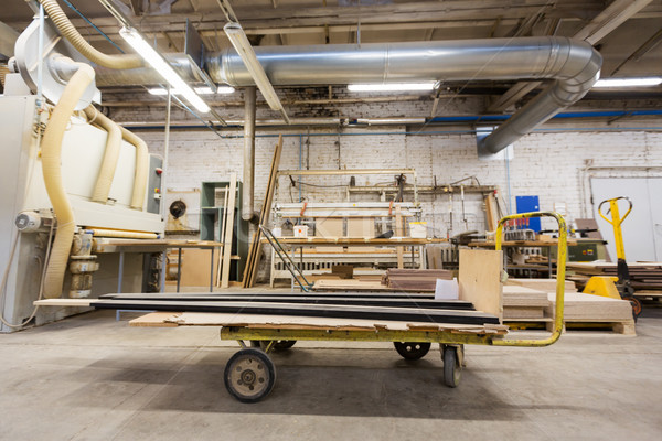 Stock photo: loader and boards at woodworking factory shop