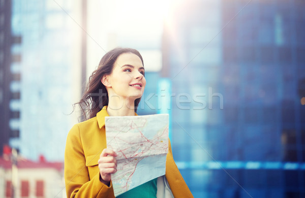 happy young woman traveling with map in city Stock photo © dolgachov