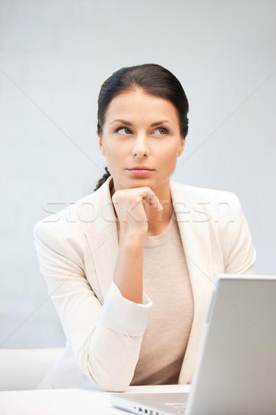 Pensativo mulher computador portátil quadro negócio escritório Foto stock © dolgachov
