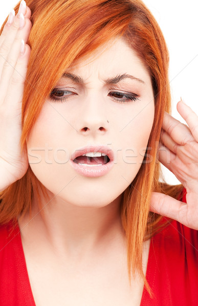 unhappy redhead woman Stock photo © dolgachov