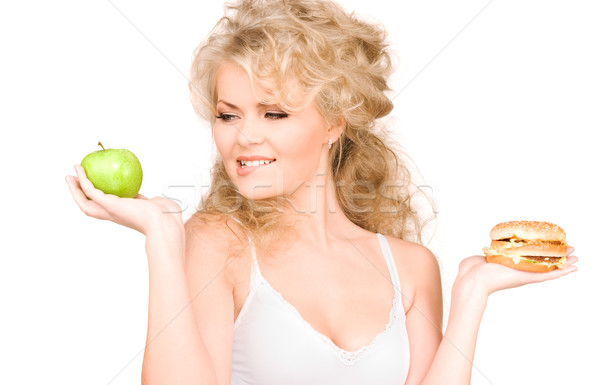 woman choosing between burger and apple Stock photo © dolgachov