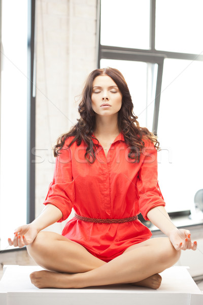 calm attractive woman in lotus pose Stock photo © dolgachov