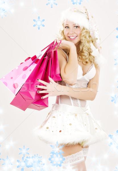 Derűs mikulás segítő lány bevásárlótáskák kép Stock fotó © dolgachov