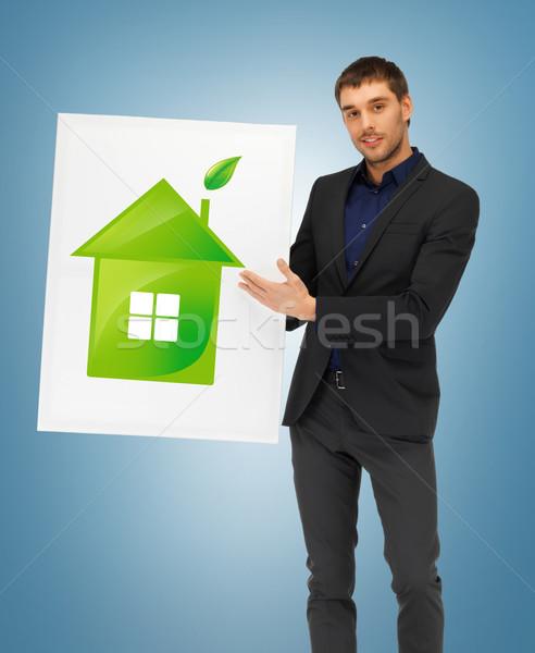 Stock photo: handsome man illustration of eco house